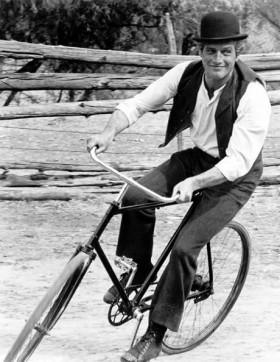 Paul Newman rides a bike